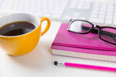 Modern office workspace with coffee, computer and glasses. Office worksapce with computer and glasses stock photo