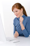 Modern office - young business woman. Work at computer Royalty Free Stock Image