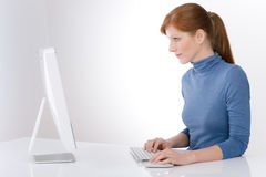 Modern office - young business woman. Work at computer Stock Photography