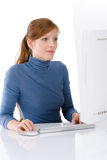 Modern office - young business woman work. At computer Stock Photography