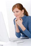 Modern office - young business woman work. At computer Stock Image