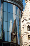 Modern and old. Reflection of the cathedral of Vienna in crystals of a modern glass building Royalty Free Stock Photos