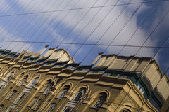 Modern and old architecture. Mixed in the reflection Royalty Free Stock Photos