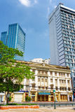 Modern and old architecture of buildings in Ho Chi Minh, Vietnam. Contrast of modern and old architecture of buildings in Ho Chi Minh city. Hotels on blue sky Stock Photography
