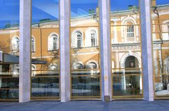 Modern and old architecture of Moscow Kremlin. Arsenal building is reflected in the Big Kremlin Concert hall glass wall. Moscow Kremlin is a popular touristic Stock Images