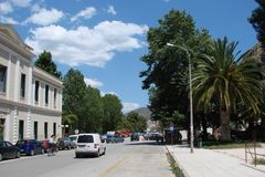 Seaside town of Kalambaka in southern Greece in the summer of 2014. Panorama of the central part and the clean sunny streets of th Stock Image