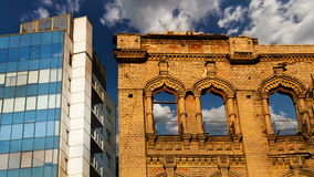 Modern and old Buildings with Clouds Timelapse Stock Images