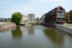 Modern and old buildings at Odra river canal in Wroclaw, Poland. Stock Images