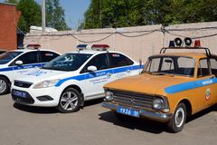 Modern and old cars of the road patrol service of the police. Royalty Free Stock Photography