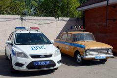 Modern and old cars of the road patrol service of the police. Stock Photo