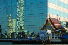 Modern and old style building. Modern and old style combine together as part of Thai life Royalty Free Stock Photography