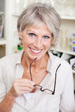 Modern older woman at home Royalty Free Stock Image