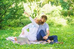 Modern online business. Freelance life benefit concept. Couple youth spend leisure outdoors working with laptop. How to stock photos