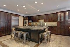 Modern open floor kitchen design in grey tones Royalty Free Stock Image