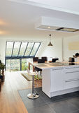Modern open kitchen in renovated house Royalty Free Stock Photos