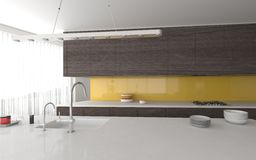 Modern open-plan yellow and grey kitchen Royalty Free Stock Photo