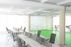 Modern open space office with football field behind the transpar Royalty Free Stock Photography