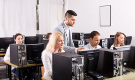 Modern open-space office. Modern office with head and successful team. Focus on the blond woman royalty free stock image