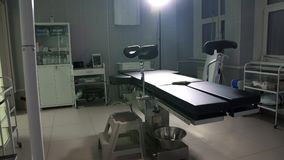 Modern operating table medical devices ,operating room dolly. Modern operating table medical devices ,operating room background Royalty Free Stock Images