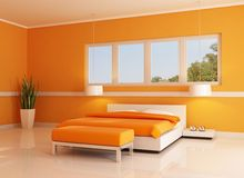 Modern orange bedroom Royalty Free Stock Photo