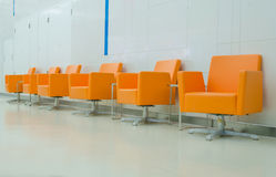 Modern orange chair style in room Stock Images