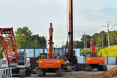Modern orange excavator machines Royalty Free Stock Images