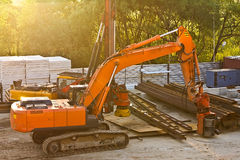 Modern orange excavator machines Royalty Free Stock Image