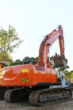 Modern orange excavator machines Royalty Free Stock Photography