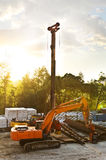 Modern orange excavator machines Stock Image
