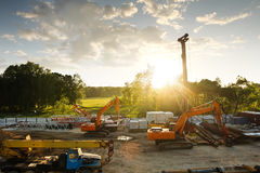 Modern orange excavator machines Royalty Free Stock Photo
