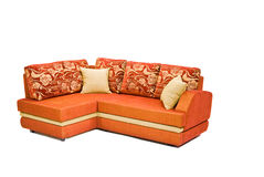 Modern orange sofa isolated on white Royalty Free Stock Photos