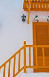 Modern orange stairs and door. Of the terrace of the mall Stock Image
