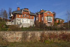 Modern Сottages. Modern three-storied city cottages in summer Royalty Free Stock Image