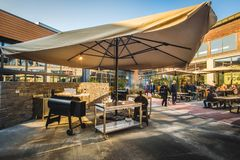 Modern outdoor barbecue grill restaurant Fico Eataly World. Modern outdoor barbecue grill restaurant at Fico Eataly World in Bologna, Italy, 19 Nov 2017 stock photography