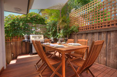 Modern outdoor living area with timber setting Stock Photos