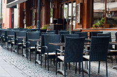 Modern outdoor terrace. Empty outdoor terrace on a old stone paved street Stock Image