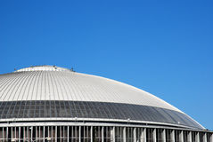 Modern oval roof. Detail of a modern oval roof with blue sky Stock Images