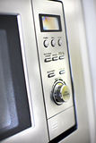 Modern oven control panel close up with buttons and knob Stock Photos