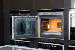 Modern oven with door open Stock Photos