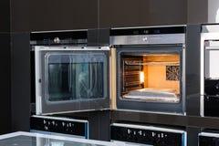 Modern oven with door open Stock Photos