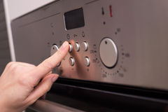 Modern oven's button Stock Photos