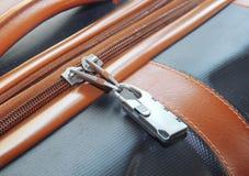 Modern padlock closeup on brown suitcase Stock Photos