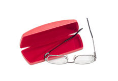 Modern pair of eyeglasses and red glasses case Royalty Free Stock Image