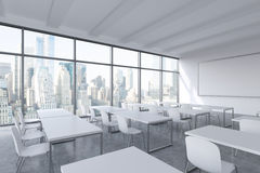 A modern panoramic classroom with New York view. White tables and white chairs. Stock Images