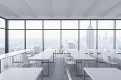 A modern panoramic classroom with New York view. White tables and white chairs. Stock Image