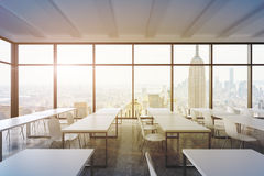A modern panoramic classroom with New York view. White tables and white chairs. Royalty Free Stock Image