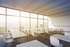 A modern panoramic classroom with New York view. White tables and white chairs.  Royalty Free Stock Images