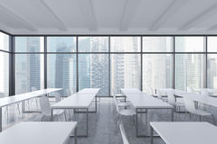 A modern panoramic classroom with Singapore view. White tables and white chairs. Royalty Free Stock Photo
