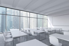 A modern panoramic classroom with Singapore view. White tables and white chairs. Royalty Free Stock Images