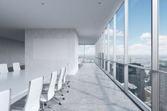 Modern panoramic conference room. A white rectangular table and chairs around it. Stock Images